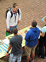 A student talks to representatives at the SPU Church Fair