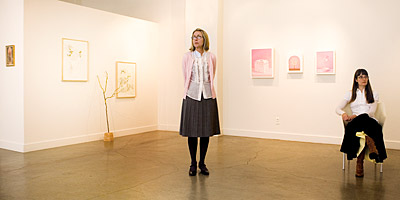 Laura Lasworth and Katie Kresser photographed inside SPU Art Center Gallery