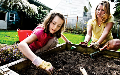 Jennifer Perrow and her daughter Allie in their garden.