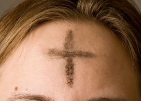 A cross of ashes on a worshiper's forehead