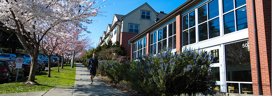 student walking near Emerson Hall