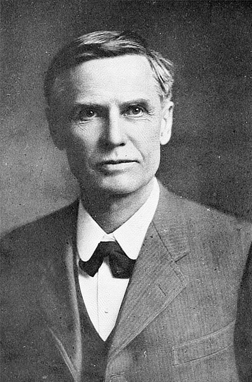 A black and white headshot of William Simon Uren
