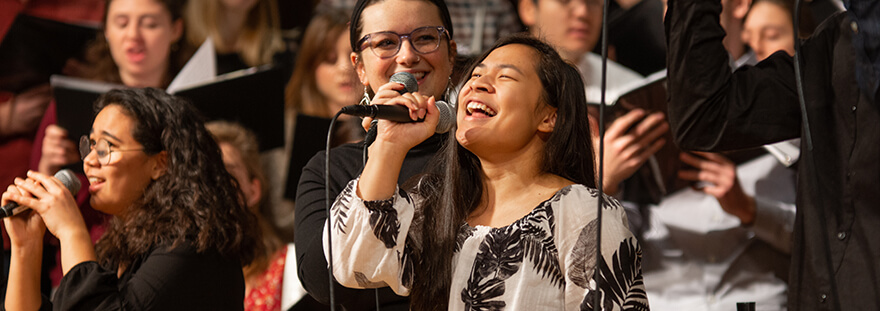 Woman singing during worship service