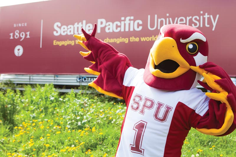 Talon in front of an SPU billboard