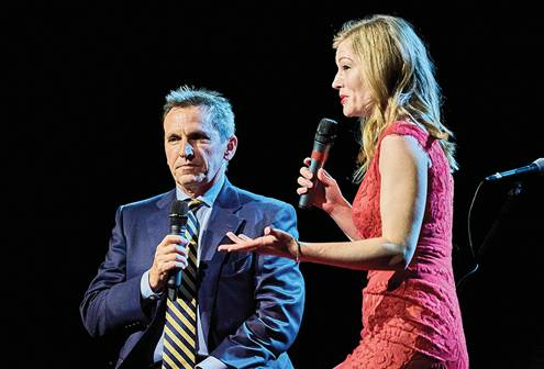 Kristen Eddings Tetteh '06 interviews Jeff Hussey '83 at SPU's 125th anniversary gala