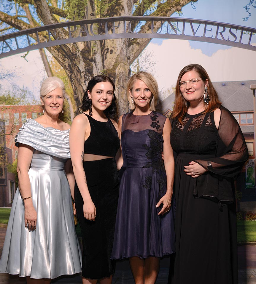 Left to right: Furrow, student designer Sarah Maberry, Pam Martin, and apparel design faculty member Sarah Mosher.