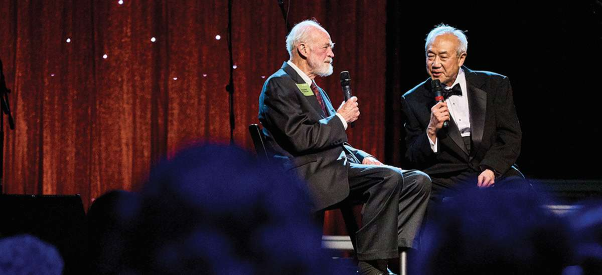 Skip Li '66 (right) interviews Eugene Peterson '54, author of The Message, during the gala