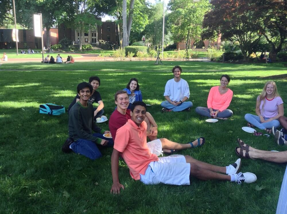 Students hanging out on the lawn with Dr. Robinson