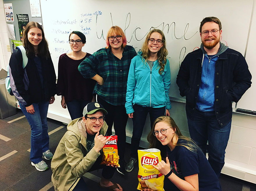SPU History majors having a club meeting, hanging out and eating chips