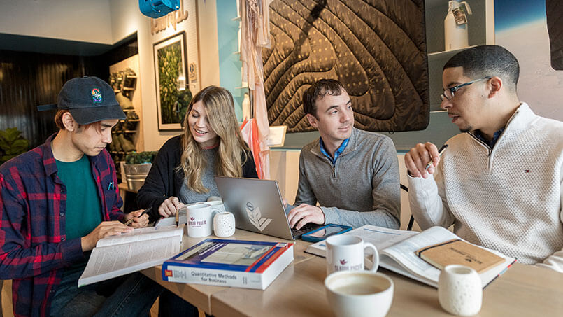 SPU grad students work on a group project | photo by Dan Sheehan