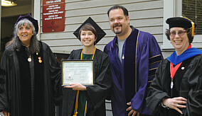 Graduate receiving award