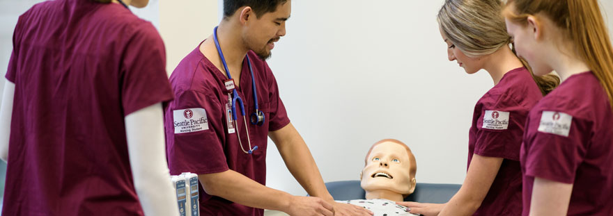 nursing students test on dummy patient