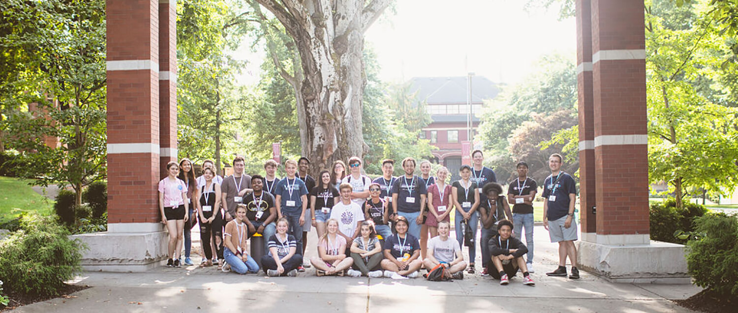 Immerse 2019 group shot under the arch at SPU