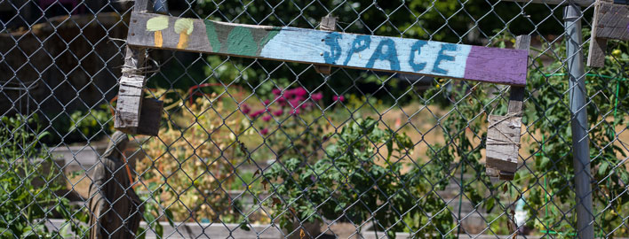 "community garden sign reads ""space"""