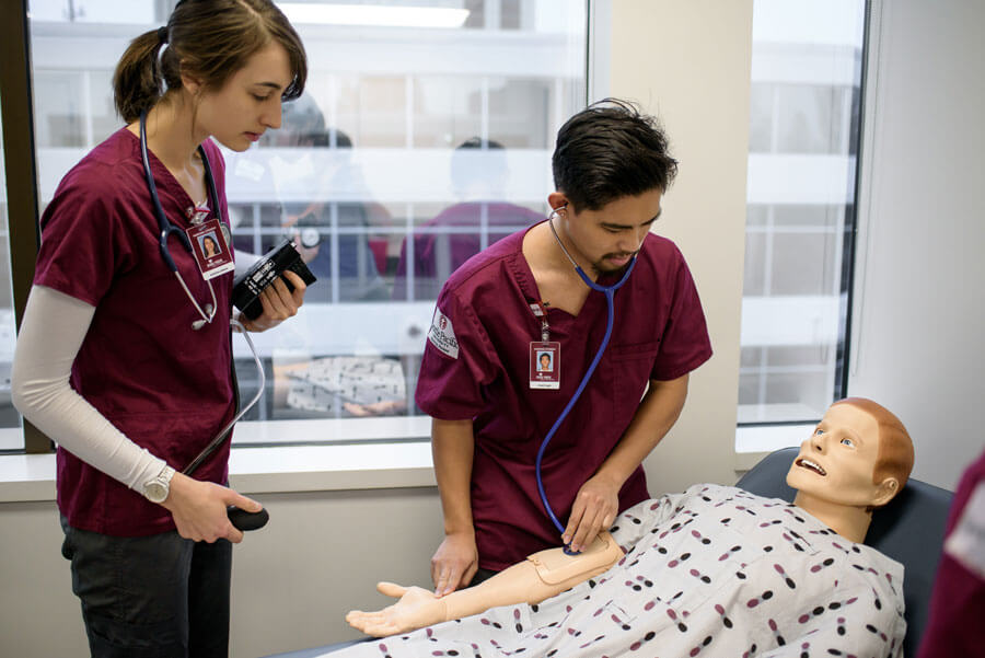 nursing students practice in classroom