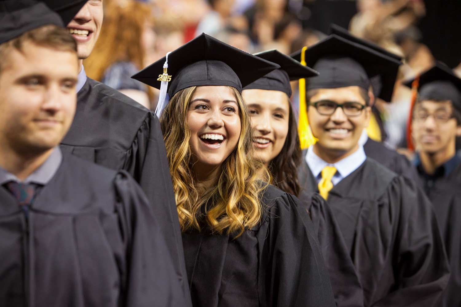 Recent grads at Commencement 2015