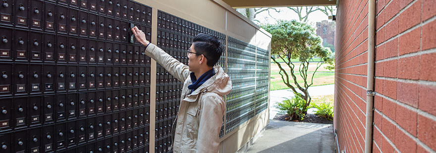 An SPU student checks his mailbox