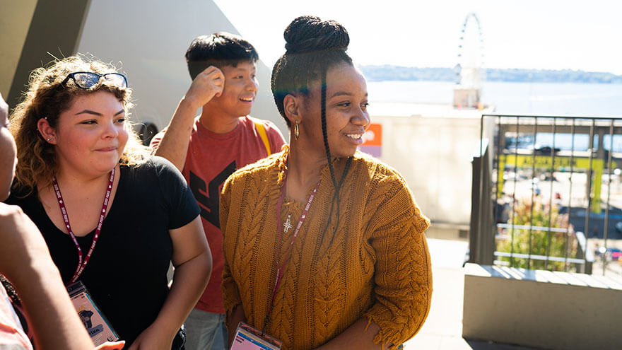 Students smile in the sunlight during the Early Connections downtown Seattle excursion