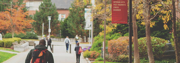 A student walks home after a day of class