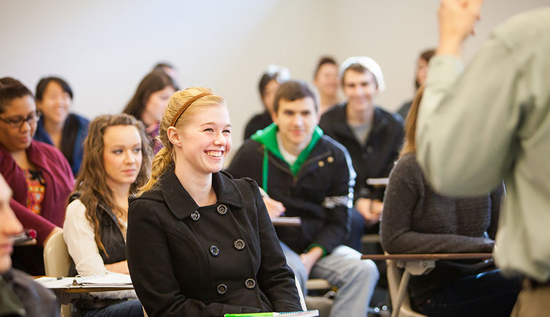 School of Theology, student laughing in classroom