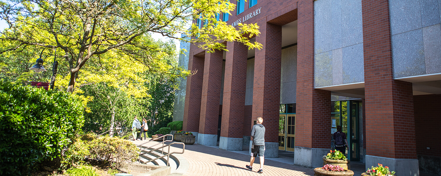A student walks past the Ames Library on the Seattle Pacific University campus.