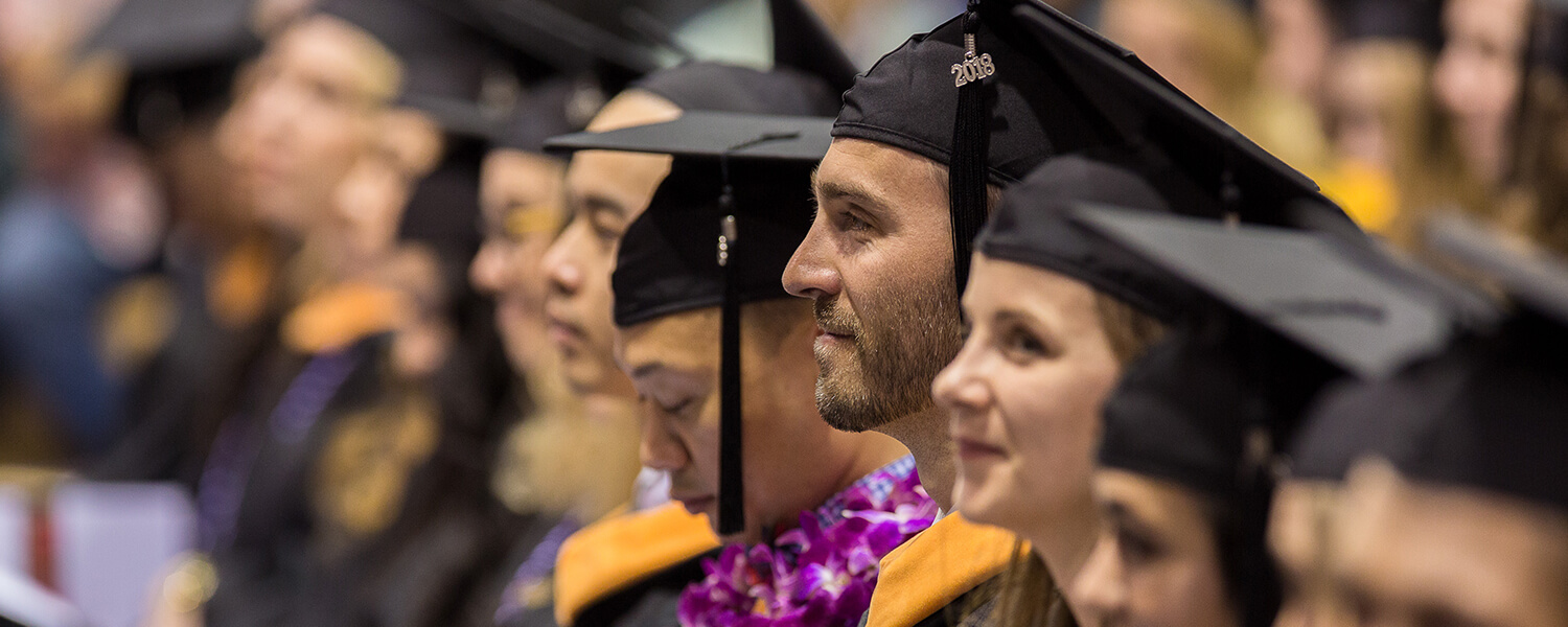Graduate students participate in Graduate Commencement at Seattle Pacific University.