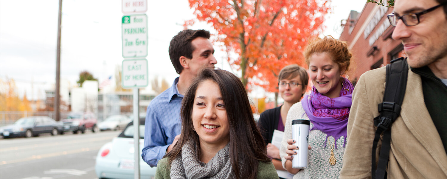 Graduate students from Seattle Pacific University walk together on campus.