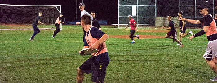 SPU students playing intramural ultimate frisbee at night