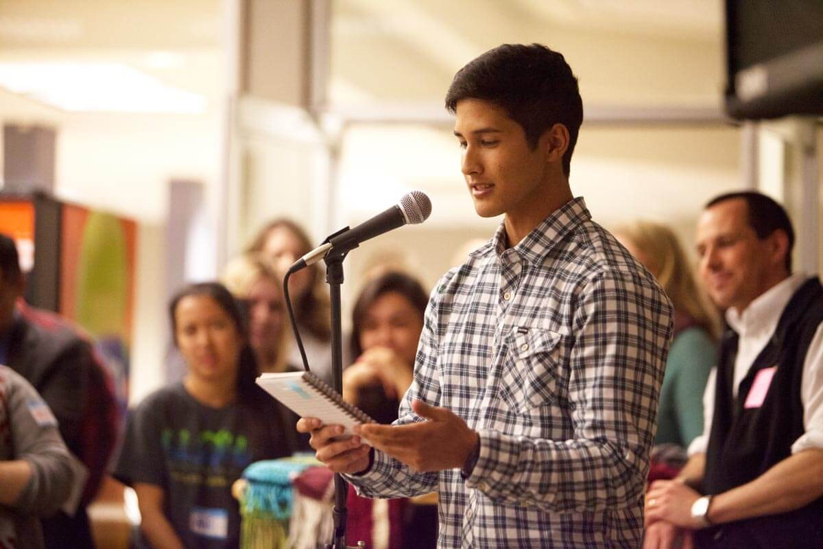 Student speaking in front of a crowd