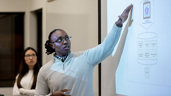 An SPU student presents in a master's program course