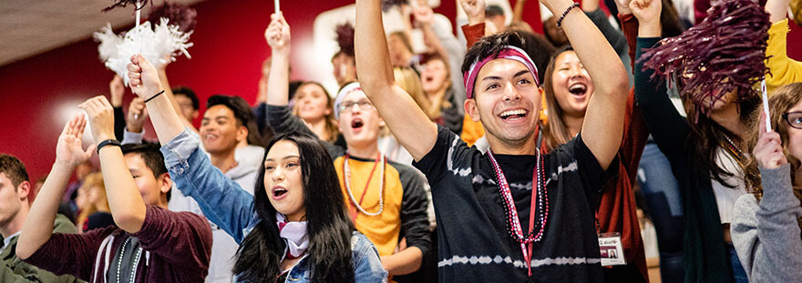 Seattle Pacific University students cheer at a volleyball game