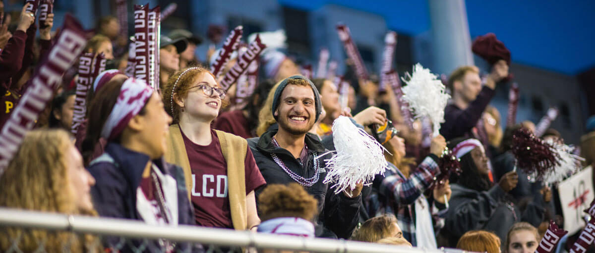 SPU students and fans cheering at men's soccer game