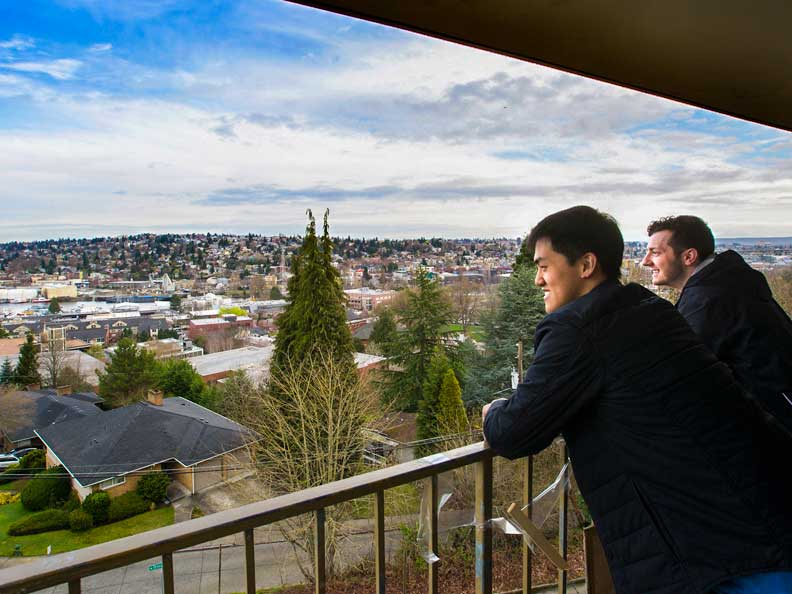 Two students overlooking the campus from an Ashton balcony
