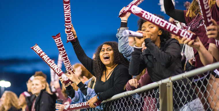 students cheer at soccer game
