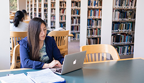 A student studying in SPU's library